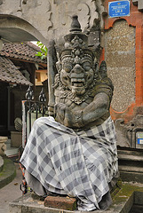 Demon statue in front of the Pura Dalem Semawa