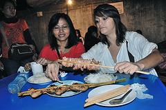 Enjoy fresh roasted chicken and pork sticks