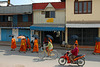Monks walk along the Chao Siphouphan