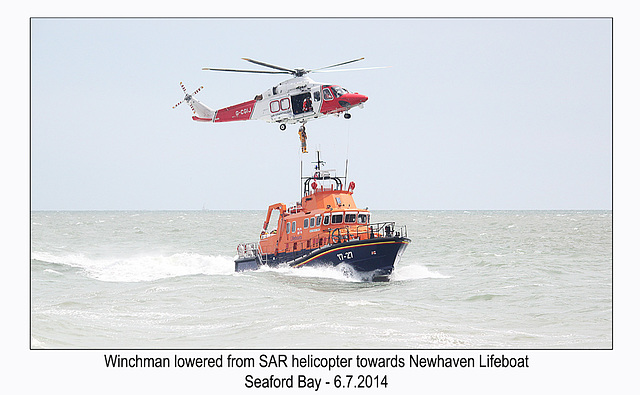 Winchman lowered towards Lifeboat - RNLI & Coastguard Joint Exercise - Seaford Bay - 6.7.2014