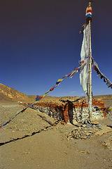 Long mani wall and a prayer flag