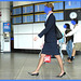 Hôtesse de l'air bien chaussée. /  Tall & slim beautiful flight attendant in high heels - Aéroport de Montréal- 18 octobre 2008 - Anonymous blue faces / Visages bleus et anonymes