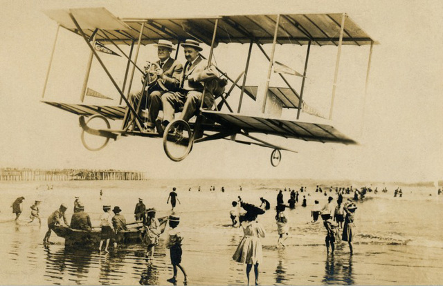 Buzzing the Beach in a Biplane, Los Angeles, Calif.