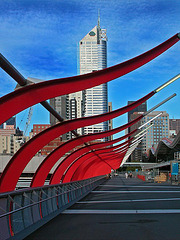 Skyline of Melbourne an a pedestrian overpass