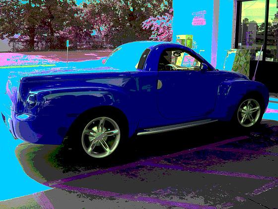 Kangaroo express red car /  Véhicule rouge kangourou - Louisiane. USA - 7 juillet 2010 - RVB en bleu postérisé
