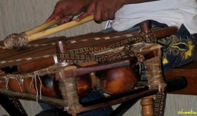Playing a balafon..