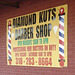 Diamond kuts barber shop sign /  Salon de coiffure louisianais - Bastrop /  Louisiane. USA - 08 juillet 2010