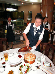 Serving Peking Duck in a Chinese Restaurant