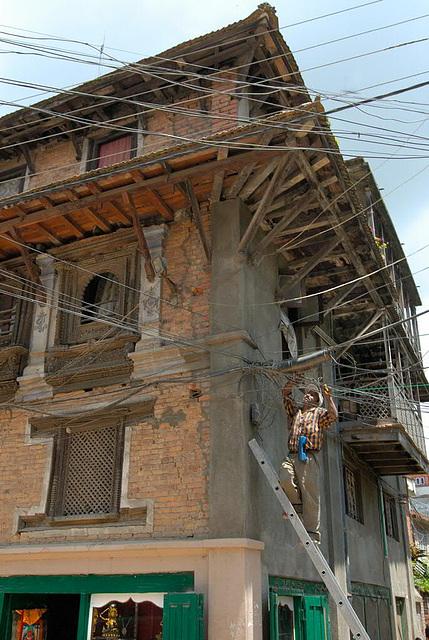 Repairing electricity lines in Patan