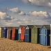 Beach Huts under sunny skies.
