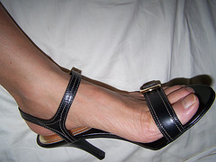 wife in strappy sandals