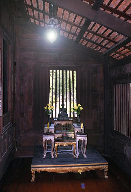 Buddha room inside a Thai house