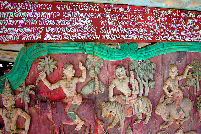 Wooden carvings and a scripture in Mueang Boran