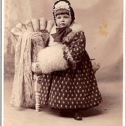Little Girl in Fur Coat With Muff