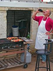 Matthew preparing barbecue