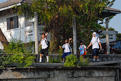 Pupils going home along the Khlong Saen Saeb