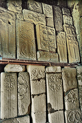 bakewell church, derbyshire,large collection of c13 cross slabs found reused in later building works, mostly in the late c13 central tower.