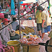 Fruit stall and passing customers