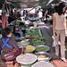 Walking on the rail through the market