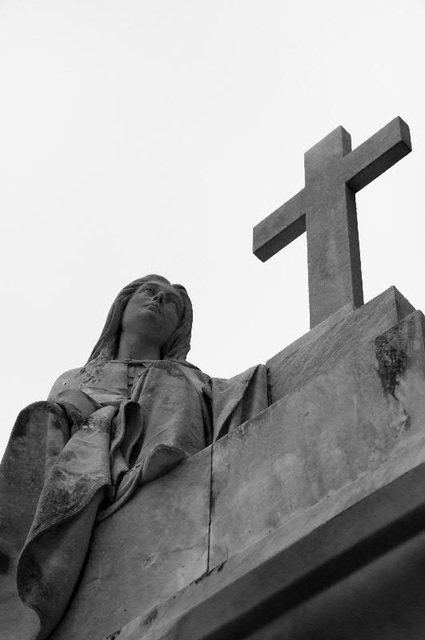 statue with cross