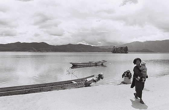 Mosuo woman with a grandchild