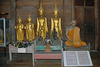 Buddha images and a dignitary wax work