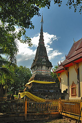 Holy chedi beside the temples building