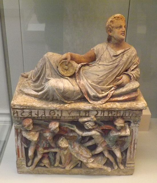 Painted Etruscan Terracotta Cinerary Urn with a Reclining Man on the Lid in the British Museum, May 2014