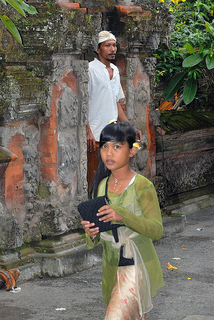 Little girl steps out the temple