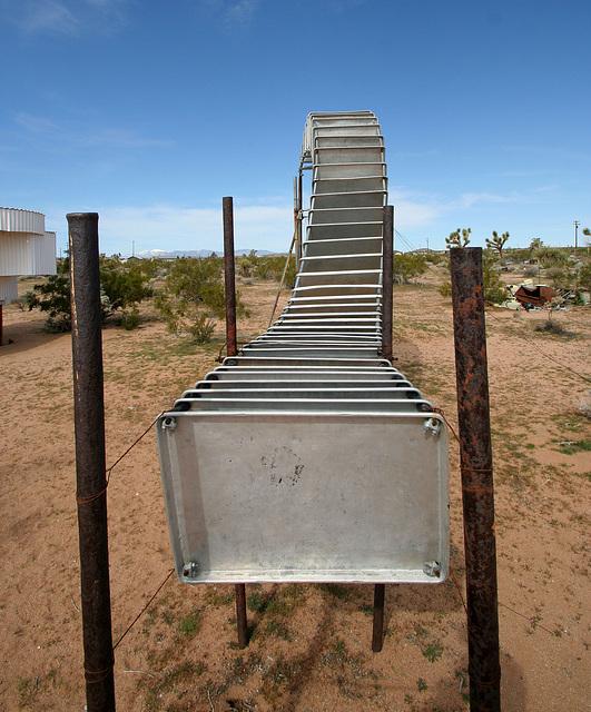 Noah Purifoy Outdoor Desert Art Museum - Sixty-Five Aluminum Trays (9845)