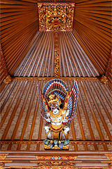 Balinese house gable and a Garuda statue