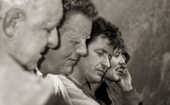 men, listening devoutly......