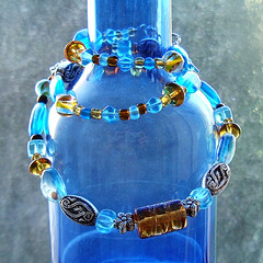 blue bottle and glass beads