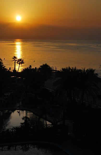 Sol de amanecer, arriba y abajo