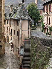 PA112990ac Conques Narrow Streets with a Staircase to St Foy
