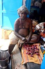 The cook. Peeling onions.