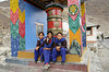 Schoolgirls and prayer wheel
