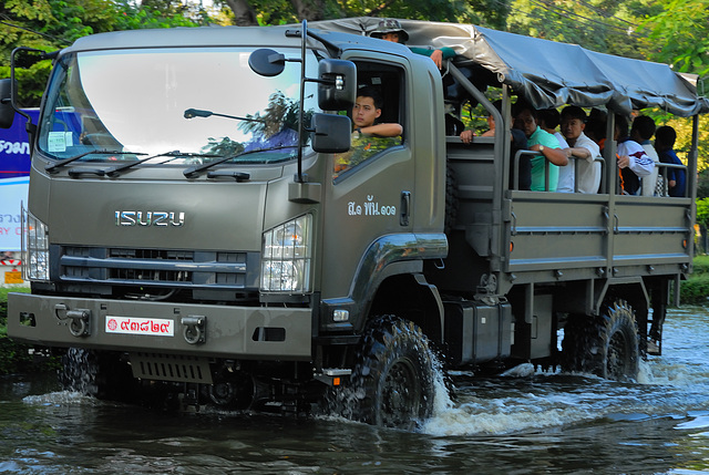 Army truck evacuating residents