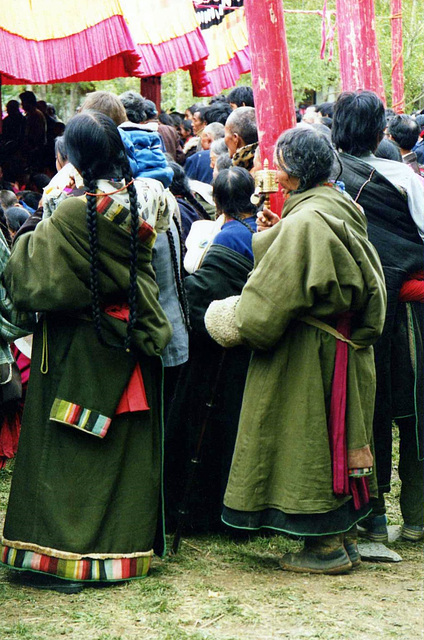 Tibetan pilgrims in traditional dress. Xiahe.