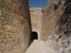 "Entrance to Spinalonga known as ""Dantes Gate"". From darkness there was light."