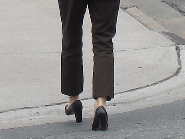 Lady Caution in high heels / La Dame Caution en talons hauts.