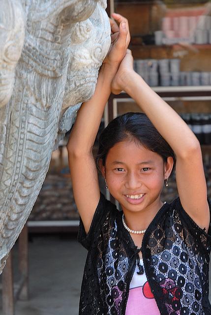 Vendor Khmer girl at the market of Phnom Kulen