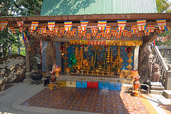 Holy altar on the steps to the reclining Buddha