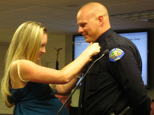 Officer Greg Blum pinned by his wife (1866)