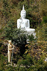White Buddha statue at the mountainside