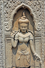 The smiling Apsara in Baphoun temple