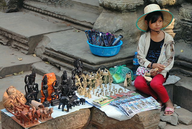 Young souvenir vendor inside Ta Prohm