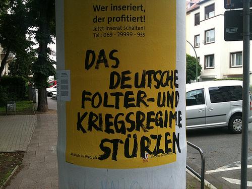 Intervention an einem Plakat der Gelben Seiten