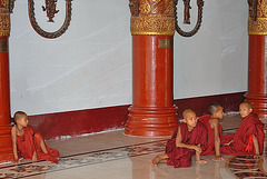 Young monks resting on the floor