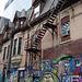 Sortie de secours et créations murales / Fire escape and wall artwork.